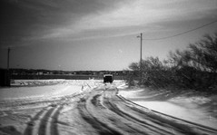 Trails in the Snow (beccachairin) Tags: travel winter blackandwhite bw white black film monochrome contrast 35mm highcontrast olympus xa2 transportation marthasvineyard grayscale olympusxa2 vignette 2013