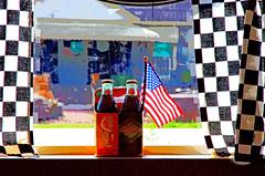 DINER JEWELS    6038 (scenesaver) Tags: flag diner checkers cokebottles