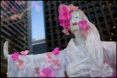 Spring goddess in a West Georgia window (Eric Flexyourhead) Tags: city flowers urban canada detail mannequin window glass shop vancouver buildings reflections office store spring origami downtown bc skyscrapers display britishcolumbia towers blossoms goddess sakura dummy fragment westgeorgiastreet olympusep1 panasoniclumix20mmf17