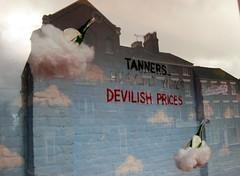 Tanners wine merchants, Shrewsbury - window display (wonky knee) Tags: uk clouds shropshire dream schaufenster shrewsbury shopwindow windowdisplay nuages heavenly reve windowdressing winebottles vitrine traum vetrine haloes volken tannerswinemerchants