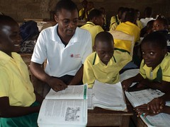 """Project coordinator sponsored by Vodafone taking the children through reading skills • <a style=""""font-size:0.8em;"""" href=""""http://www.flickr.com/photos/48668870@N02/7093353457/"""" target=""""_blank"""">View on Flickr</a>"""