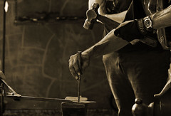 ANS-dropping the hammer (ansels_sherpa ( Gone fishing, leave a message : )) Tags: people work blackwhite hands candid blacksmith