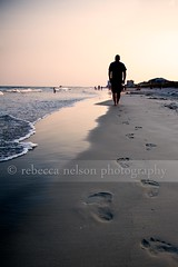 Sunset walk on the beach (Rebecca812) Tags: ocean family sunset summer vacation sky people seascape man beach water beautiful silhouette walking person walk footprints peaceful husband calm serene refelction lowangle wages canon5dmarkii rebecca812 heritage2011
