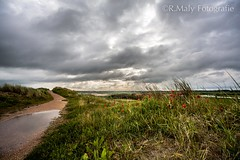 Drama in the air (René Maly) Tags: clouds canon landscape zeeland tokina 5d manualfocus westkapelle walcheren 3517 17mmf35 rmctokina renémaly