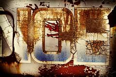 Crack design (hutchphotography2020) Tags: crackedpaint metal peelingpaint letters sign nikon