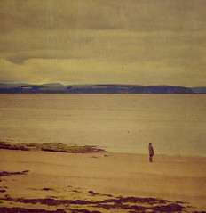 Everything changed the day she figured out there was exactly enough time for the important things in her life (puremaguire) Tags: sea beach water sand watching thinking nairn storypeople
