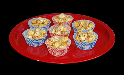 carmel corn in stripped red and blue cupcake liners for 4th of July