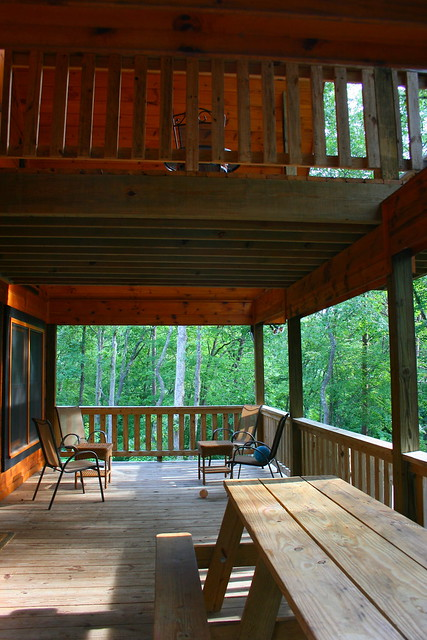 Main level deck with view of upstairs deck area