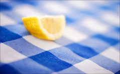 complements (helen sotiriadis) Tags: blue summer white macro yellow closeup fruit canon table restaurant lemon dof bokeh depthoffield gingham greece tavern tablecloth tilt canonef50mmf14usm gytheio canoneos40d