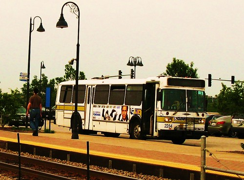 Pace bus waiting at The Glen of North Glenview Metra commuter rail station. Glenview Illinois USA. June 2011. by Eddie from Chicago