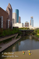 Two people kayaking on a city river (Downtown Houston) (jim_david) Tags: city travel urban tourism water skyline buildings river outdoors boat healthy downtown kayak cityscape texas skyscrapers exercise stock paddle houston lifestyle adventure bayou health kayaking boating metropolis leisure recreation fitness paddling buffalobayou