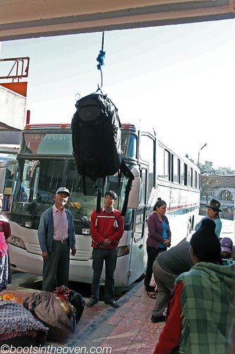 Luggage being lowered to the bus