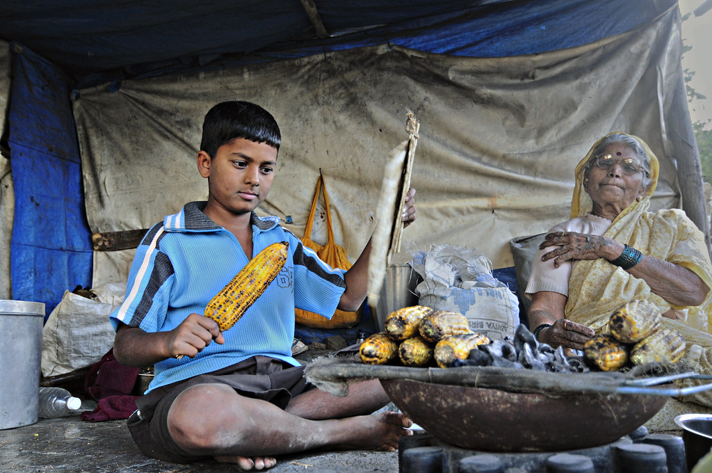 Corns and Street Food - Portrait Of A Young Corn Seller And His Grandmother At Pune - Color