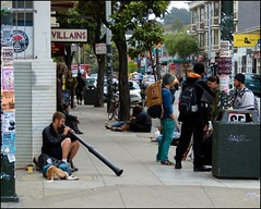 high on haight...... (ana_lee_smith) Tags: sanfrancisco california street people musician music youth traffic australian musical haightashbury signage instrument pedestrians intersection aboriginal stores crossroads congestion hanginout ashbury digeridoo thehaight analeesmith