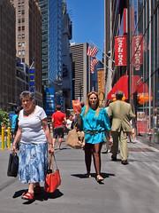 midtown melange (zlandr) Tags: street city nyc newyorkcity urban newyork streets vertical colorful manhattan candid olympus midtown sp 40 unaware ep1 spnp streetphotographynow streetphotographynowproject chrisfarling zlandr instruction40