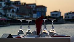 Your table, Sir (Steenjep) Tags: samos holiday ferie greece grækenland kokkari sun sunset sol solnedgang restaurant table reflection reflex restaurantpiccoloporto piccoloporto glas geotagged