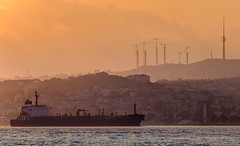 Cargo ship and the city of Istanbul at sunrise (szenasia) Tags: yellow landscape sunrise morning city sea water travel europe istanbul turkey cityscape summer orange nikon ship channel bosphorus early waterway cargo arrival arrive d610