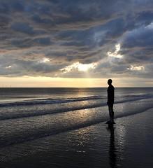 crosby merseyside coast england (plot19) Tags: uk sunset sea england sky men art nikon britain coat antony crosby merseyside gormleys abigfave anawesomeshot plot19