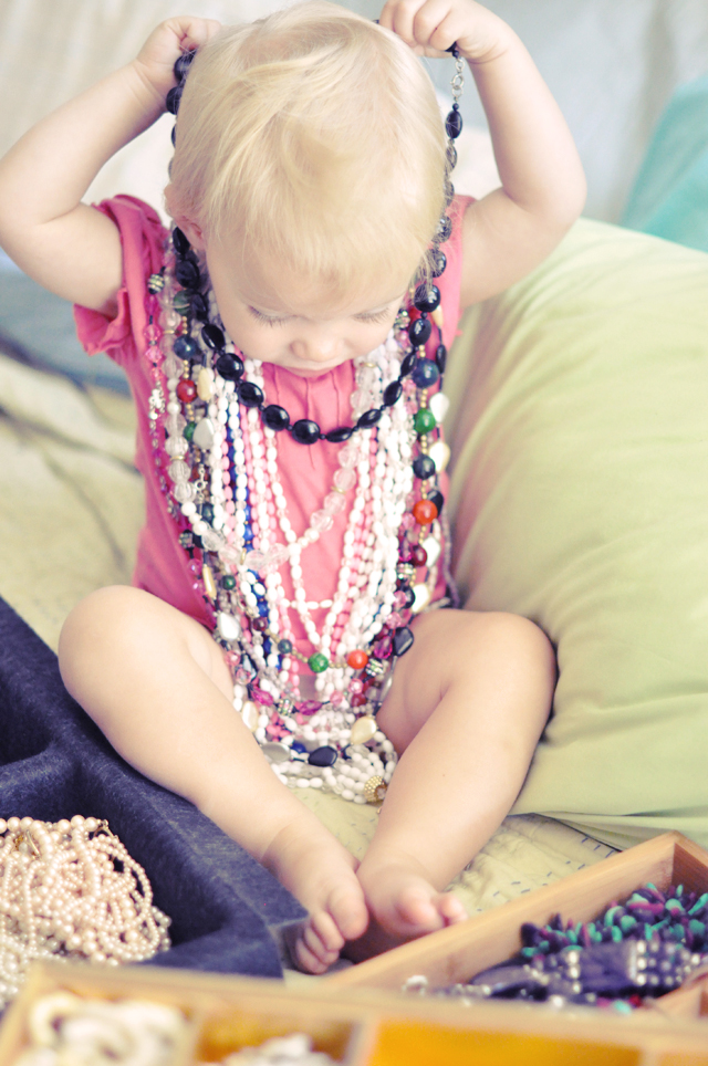 delilah trying on necklaces