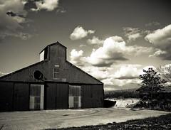 Get off of my cloud (CamMonkeh) Tags: door cambridge sky bw white black clouds barn lens prime farm farming olympus ans ep1 17mm mzuiko