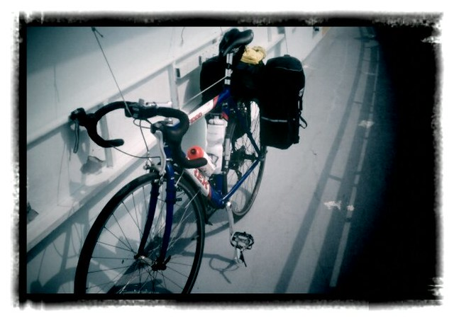 Loaded bike sitting on other forms of transport, ferry edition.