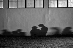 IMGP9262-stavrosstam (stavrosstam) Tags: street people bw wall couple shadows passing