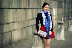 Posing for the camera (*Kicki*) Tags: a900 tourist woman person posing royalpalace stockholm sweden gamlastan oldtown handbag scarf wall pillars japanese 100mm candid people skeppsbron street girl