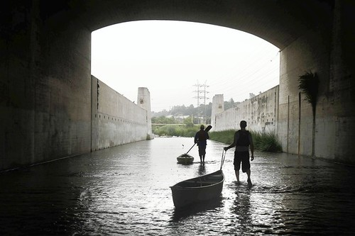 Kayakers make their way down the LA River near Atwater Village on Thursday, July 22, 2010