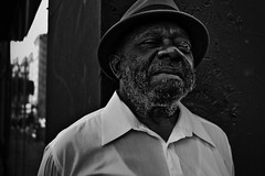 Corner Man (Rinzi Ruiz [street zen]) Tags: life portrait urban blackandwhite man black face hat corner beard photo losangeles nikon downtown bokeh picture streetportrait photograph africanamerican streetphoto fedora eyelash gentleman streetshot streetphotograpy nikond90 streetzen rinziruizphotography