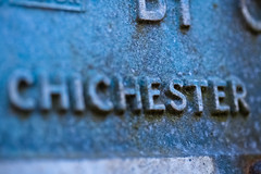 Chichester Macro (sagesolar) Tags: old blur macro sign metal sussex letters raised chichester