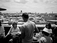 La terrasse du Caf des pices (Dahrth) Tags: blackandwhite bar restaurant noiretblanc terrace terrasse nb morocco maroc marrakech server waiter whiteandblack gf1 serveur lumix20mm gf120
