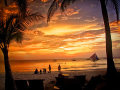 Pacific Island Sunset, Boracay, Philippines (Ray in Manila) Tags: boracay philippines asia tropical whitebeach pacific coconutpalm dog people sailing yacht boat paradise island tourist visayas bestislandintheworld sky orange