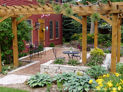 Front Yard Patio & Entry Pergola on Salt Box Home (Switzer's Nursery & Landscaping) Tags: minnesota landscape design natural landscaping glenn patio cedar handcrafted northfield interlocking pergola paver pavers switzers arbour switzer landscapedesign designbuild hardscape hardscaping customdesigned glennswitzer icpi patiodesign pergoladesign switzersnursery landscapedesigns theartoflandscapedesign switzersnurserylandscaping arbourdesign artoflandscapedesign