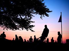 Listening (polarapfel) Tags: street travel sunset summer people tourism silhouette germany europe dusk leisure recreation lifestyles mecklenburgvorpommern warnemunde