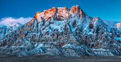 Red-Rock-Canyon-Snow-Mountains-Sunrise-Nevada-2009-002.jpg (RogueSocks) Tags: usa snow mountains weather rock sunrise rust sandstone desert lasvegas nevada conservation canyon formation geology navajo redrock hdr timeofday nevadausa