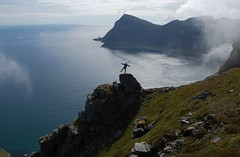 Balance (~Ranveig Marie~) Tags: pictures ocean travel sea summer sky people cliff sun mountain man guy nature grass weather norway rock stone clouds standing landscape outdoors island person star freedom europe view photos pics hiking walk horizon hill natur norwegen himmel images hike norwegian tur photographs edge noruega brave traveling scandinavia paysage lofoten balancing nordnorge naturewalk fjelltur norsk lofotenislands norvge nordland skandinavia mstad vry fottur friluft northernnorway visitnorway mostad touraroundtheworld ginordic1 ranveigmarienesse ranveignesse