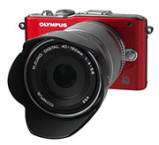 Olympus PEN E-PL3, with the 40-150 mm II R kit lens and retro lens hood.