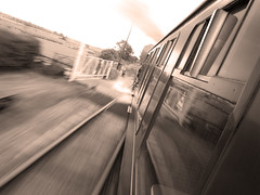 Steam sprint (RobertSteele) Tags: summer england blur window station sepia speed train canon vintage blackwhite kent britain railway powershot historic steam motionblur rails bodiam timeless steamtrain greyscale levelcrossing kesr g9 kenteastsussexrailway canong9 kesrorguk