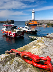 Summer returns (Ian Humes) Tags: summer lighthouse clouds harbour bluesky quay chain northernireland fishingboats donaghadee countydown lifeboats explored rlni lighthousetrek