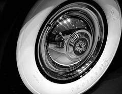 """Ham's a big wheel..."" (High) (HamWithCam) Tags: atlanta blackandwhite bw macro reflection 50mm high atl hamwithcam hwc firestone hubcap 5d2"