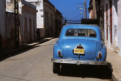Blue Dodge (Armin Schuhmann) Tags: street old blue roof shadow urban bw color classic film lamp car electric analog 35mm vintage diy wire nikon post empty cuba slide tire scan sidewalk dodge mf f2 positive spare analogue nikkor agfa fm e6 ai warming 100asa argentique filmscan diapo gibara ctprecisa nikonfm 2011 agfactprecisa100 ctprecisa100 colorpositive filmisnotdead 81a 35mmf2ai  bw81awarming 35mmnikkorkf20ai