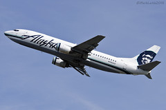Alaskan Airlines, Boeing 737-4Q8QC, N762AS. (M. Leith Photography) Tags: alaskan airlines boeing 737 combi passenger jet plane aircraft usa american alaska anchorage flying take off blue sky freight cargo ted stevens international airport 3rd august 2016 markleithphotography d7000 70200vrii nikon nikkor