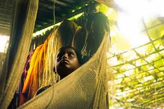Tapestry of life: Woven in life and lines (Neerod [ www.shahnewazkarim.com ]) Tags: boy net kid fisherman village child room vegetable bangladesh fishingnet mawa maowa