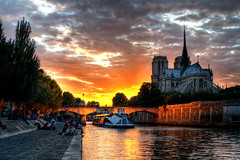Sunset over Notre Dame (ajagendorf25) Tags: bridge sunset orange sun paris france reflection church water yellow seine river french star high nikon catholic dynamic cathedral 1855 notre dame range hdr d90 ajagendorf25 alexjagendorf