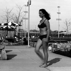 In a Hurry (fillzees) Tags: street bw woman motion blur girl ut outdoor candid bikini swimsuit swimwear