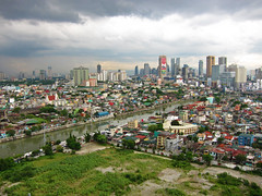 Metro Manila, Philippines (GreenArcher04) Tags: world city sky urban house building eye rooftop birds skyline modern clouds skyscraper canon river asia cityscape view metro cloudy south philippines powershot east rainy manila cebu third housing shanty rockwell boracay makati residential condominium davao s90 squatter pasig joya mandaluyong