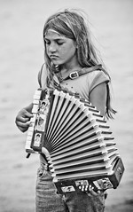 Gypsy Child Busking (ian_burton) Tags: street justin people musician music white black portraits canon eos interesting child pics candid streetphotography traveller crete accordian bandw gypsy bieber ch