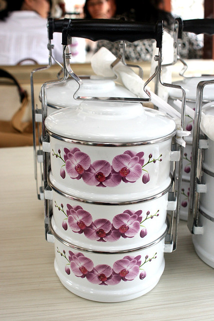 You get to bring this little baby home! This year's tiffin carrier is white with orchids