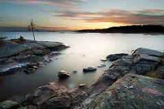 The cove - Västra Skagene (- David Olsson -) Tags: longexposure sunset lake colour tree nature water clouds landscape nikon rocks sundown sweden dusk stones cove sigma cliffs le 1020mm 1020 vänern dx hammarö värmland ndfilter lakescape smoothwater skoghall d5000 davidolsson nd500 lightcraftworkshop västraskagene 2exposuremanualblend