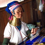 "Woman with Neck Rings Weaving <a style=""margin-left:10px; font-size:0.8em;"" href=""http://www.flickr.com/photos/14315427@N00/7070424395/"" target=""_blank"">@flickr</a>"